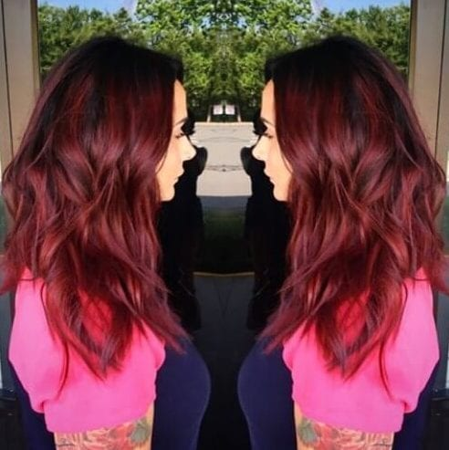 chunky burgundy highlights wavy dark hair