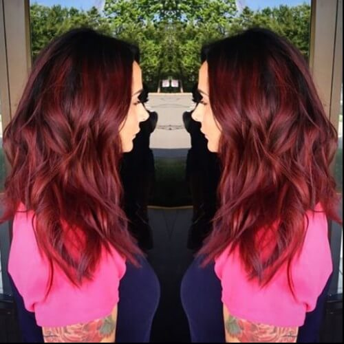 chunky burgundy highlights wavy dark hair
