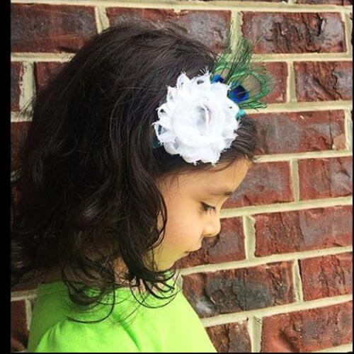curled bob with flower hair accessory