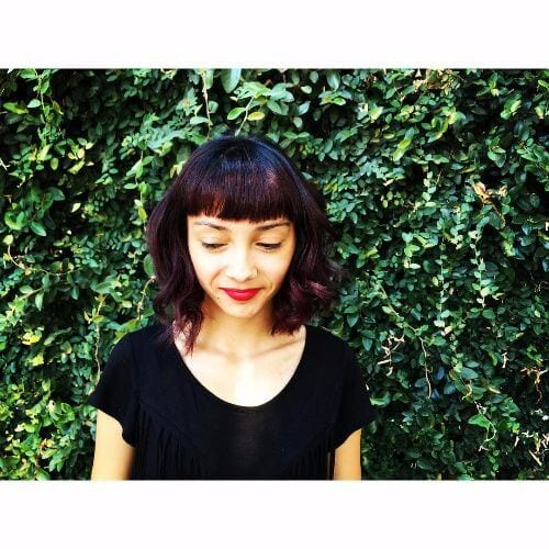 short layered hairstyle blunt bangs