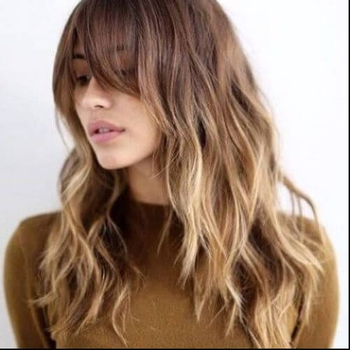 long wavy hairstyle in caramel hair color