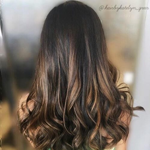 caramel hair color applied on dark chocolate hair