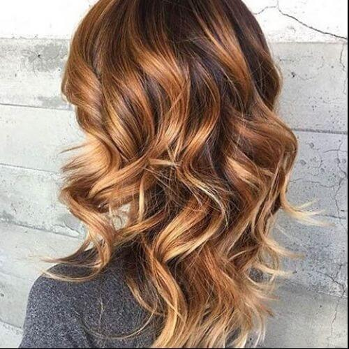 wavy hairstyle with caramel hair color