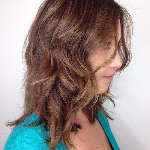 medium length hair with caramel highlights