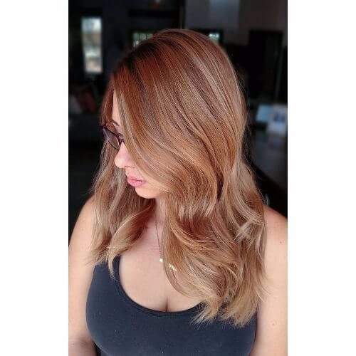 copper caramel hair color on long straight hair