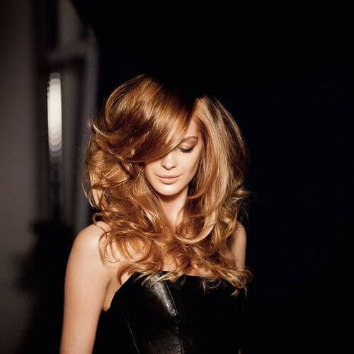 long layered wavy hair dyed in caramel hair color