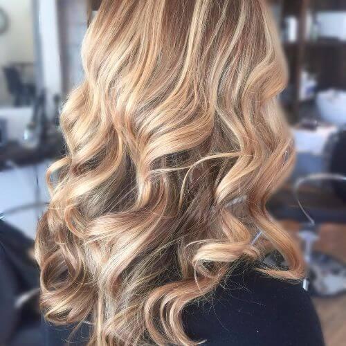 dirty blonde balayage highlights on long wavy hair