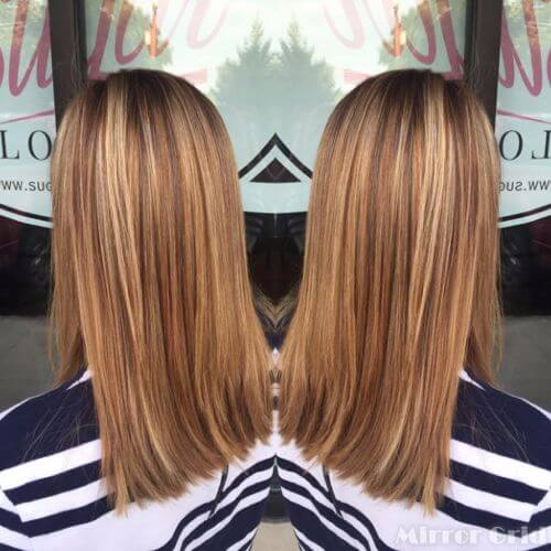 Light brown hair with caramel highlights and blonde highlights
