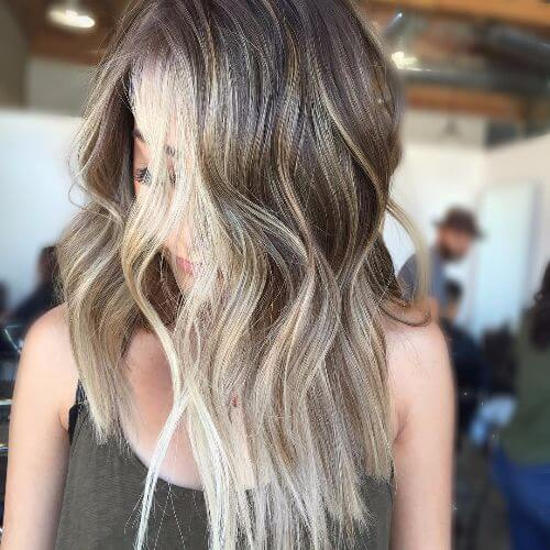 choppy layers on long hair with blonde and caramel highlights