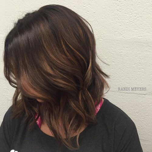 bob hairstyle with caramel balayage highlights on dark brown hair