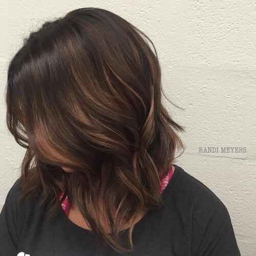bob hairstyle with caramel balayage highlights on dark brown hair