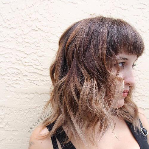 lob haircut on caramel hair with dark blonde highlights