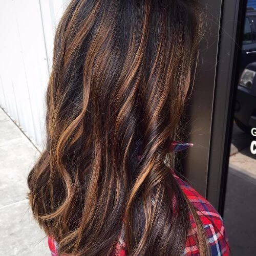 caramel highlights on long wavy hair