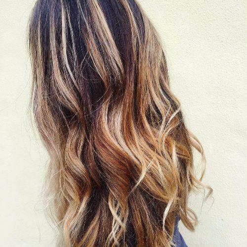 long wavy hair with caramel balayage highlights
