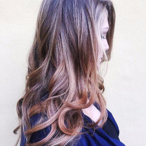 long dark hair with red caramel highlights