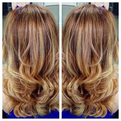 long wavy hair with red and blonde highlights