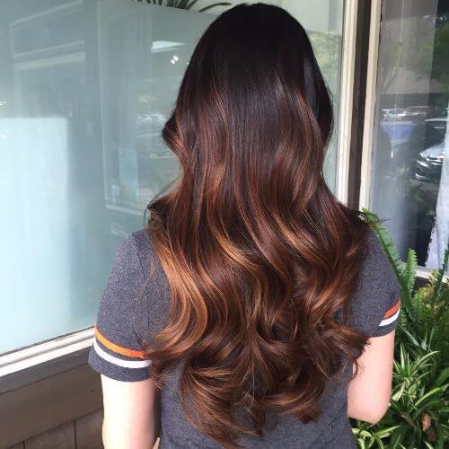 caramel highlights on long dark brown hair