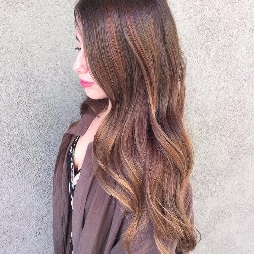long wavy hair with caramel highlights