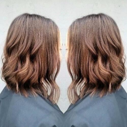 caramel highlights on wavy bob haircut