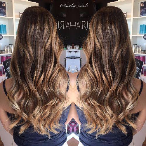 caramel highlights on wavy chocolate brown hair