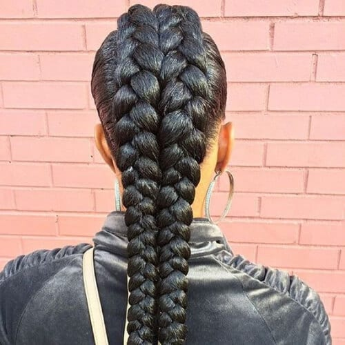 backview woman with two goddess braids
