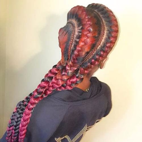 red haired woman with goddess braids