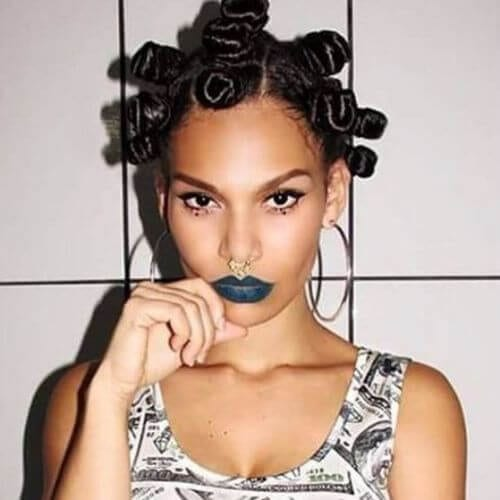 Woman with bantu knots looking towards the camera