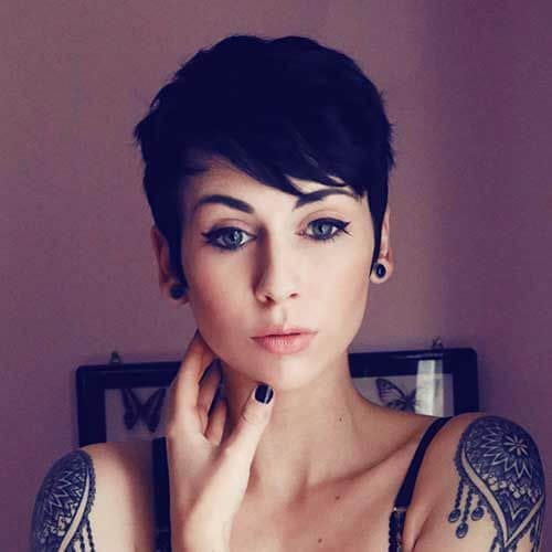 young woman shoulder tattooos pixie cut
