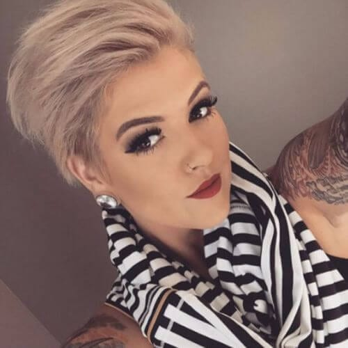 young woman tattoos selfie pixie cut