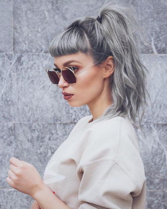 grey hair messy top ponytail and minimal bangs