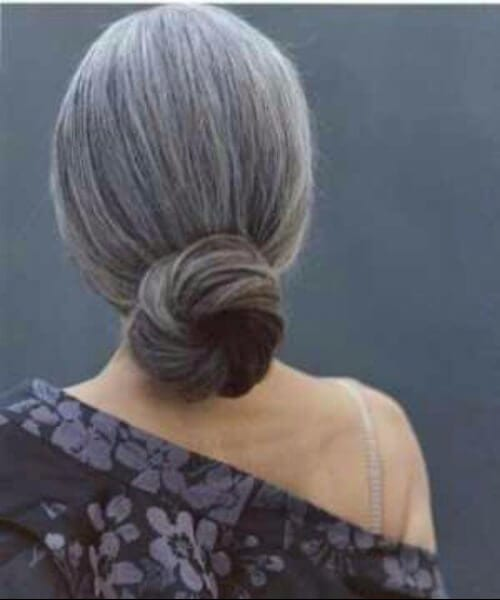 hairstyles for women over 50 grey hair low bun