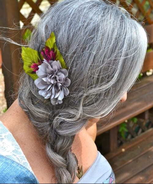 hairstyles for women over 50 long braid flowers