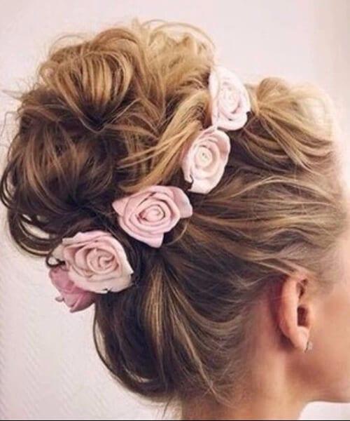 pink roses top bun homecoming hairstyles