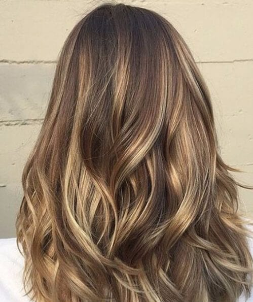 Outward waves brass shades medium length hairstyles