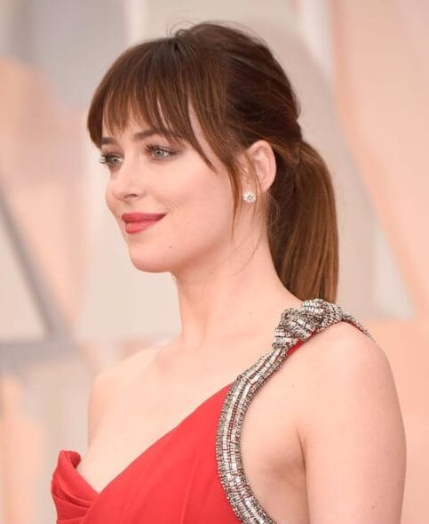 dakota johnson hairstyles with bangs