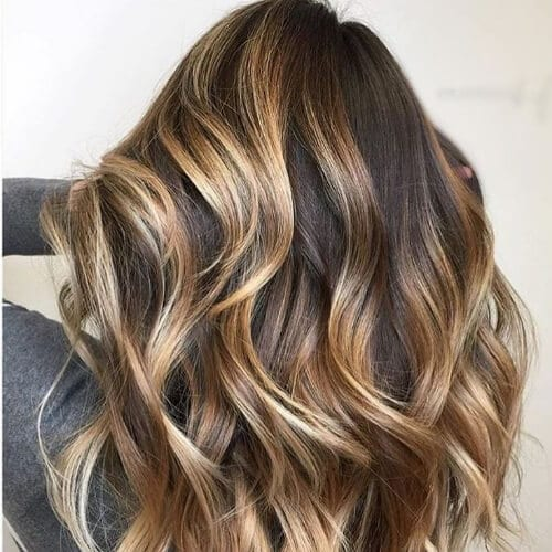 ribbons of gold brown hair with blonde highlights
