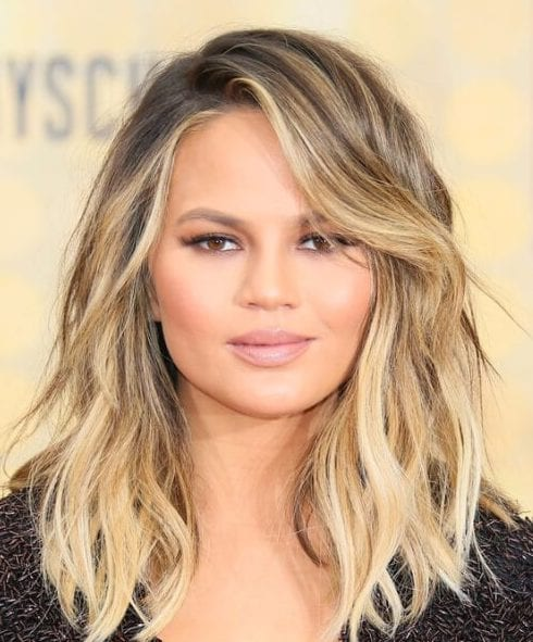 chrissy teigen side swept bangs
