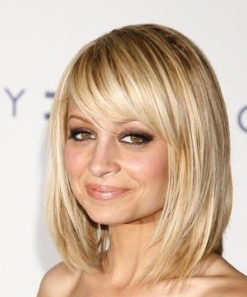 nicole ritchie side swept bangs