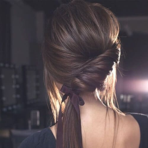 Twisted side-do with a ribbon side hairstyles for prom