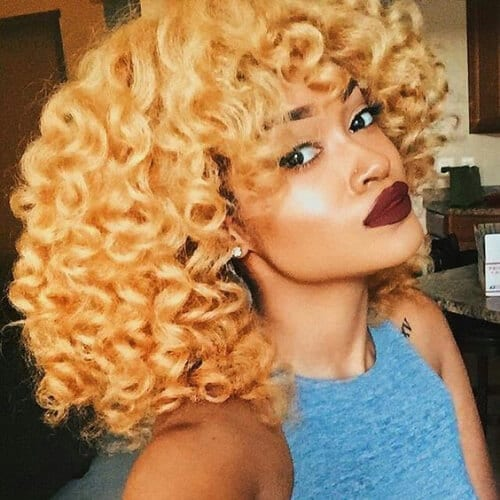 butterscotch blonde curly hair with bangs