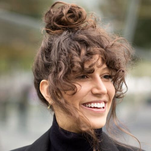 high bun curly hair with bangs