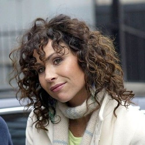 minnie driver curly hair with bangs