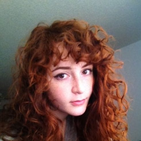 red hair curly hair with bangs