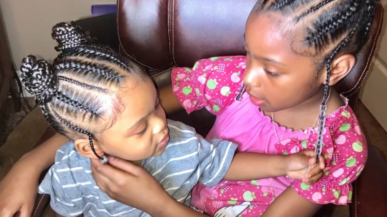 two girls has a braided buns hair