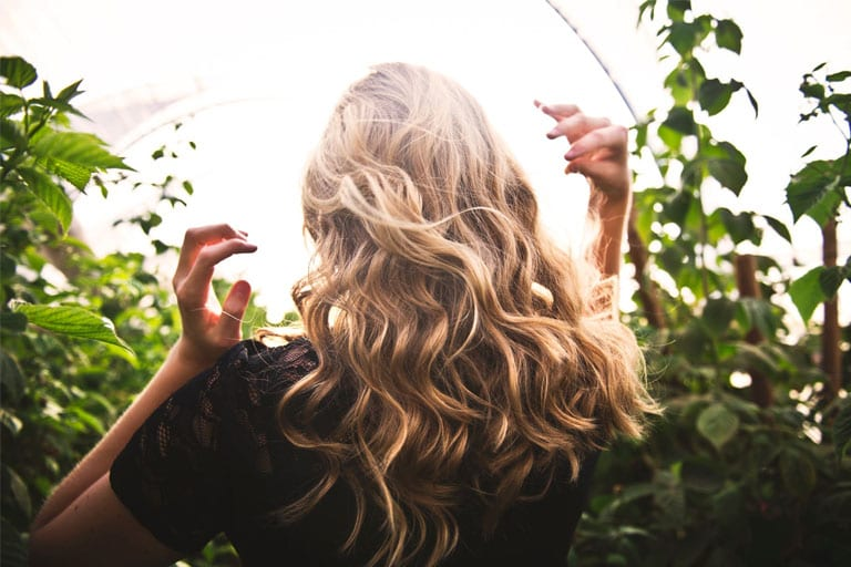 Woman On her curly blonde hair