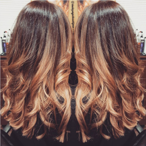 strawberry blonde ombre on wavy hair