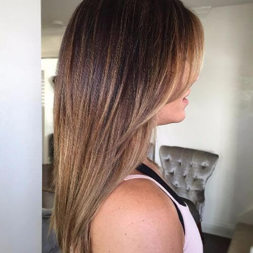 straight caramel hair with side bangs