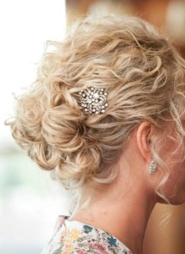 short curly hair updo with hair accessories