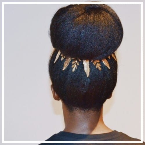 natural hair bun with hair accessories
