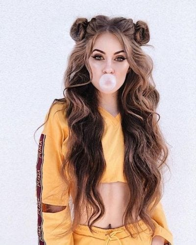 long wavy hair in double buns